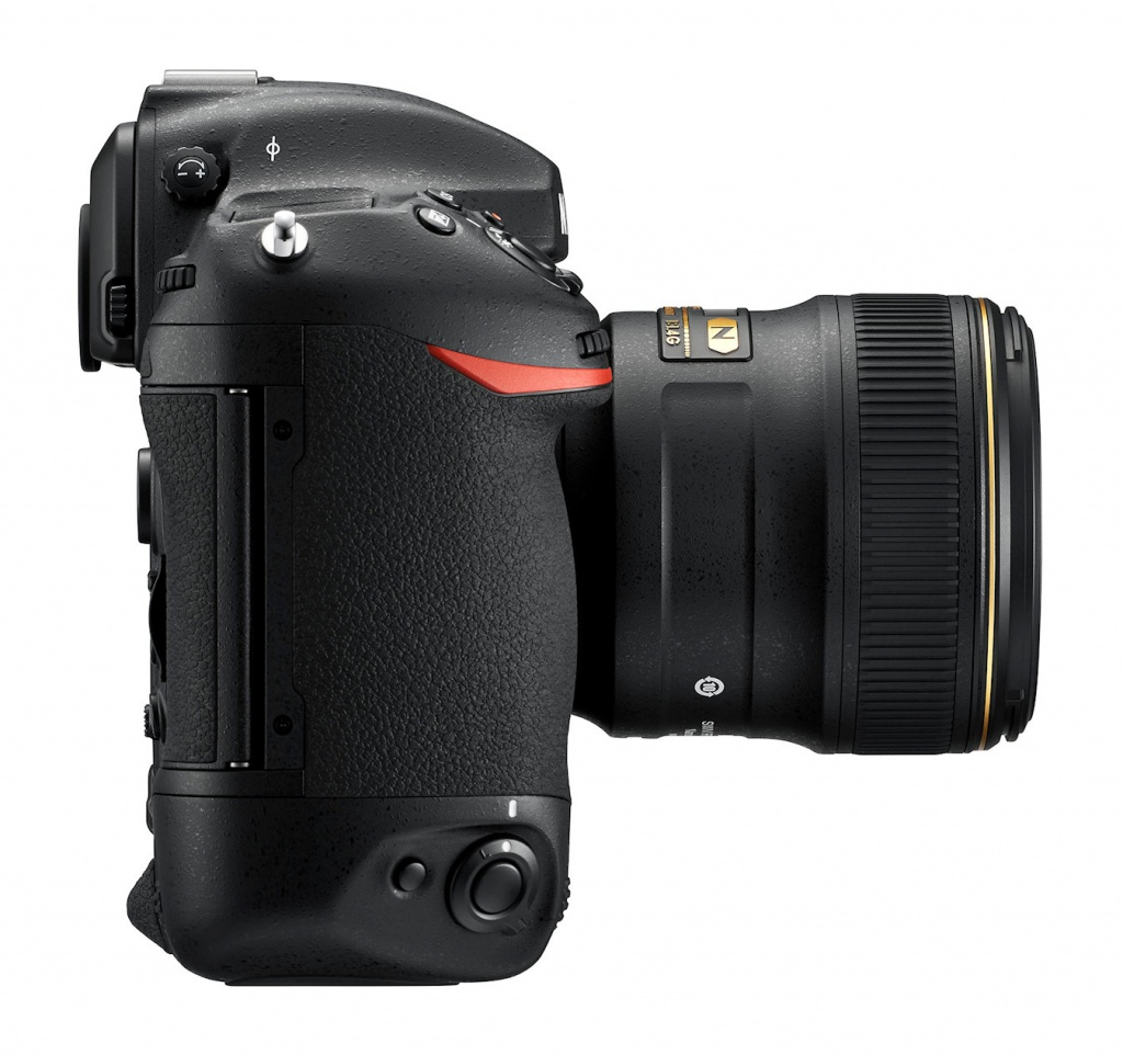 There is a secondary shutter release near the base of the Nikon D5's hand grip.