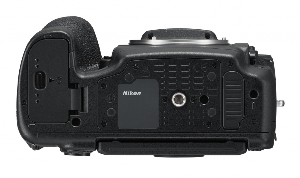 The bottom of the Nikon D850 shows a tripod socket and access to the battery chamber.