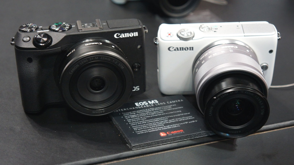 Canon EOS M3, left, and M10 mirrorless cameras.