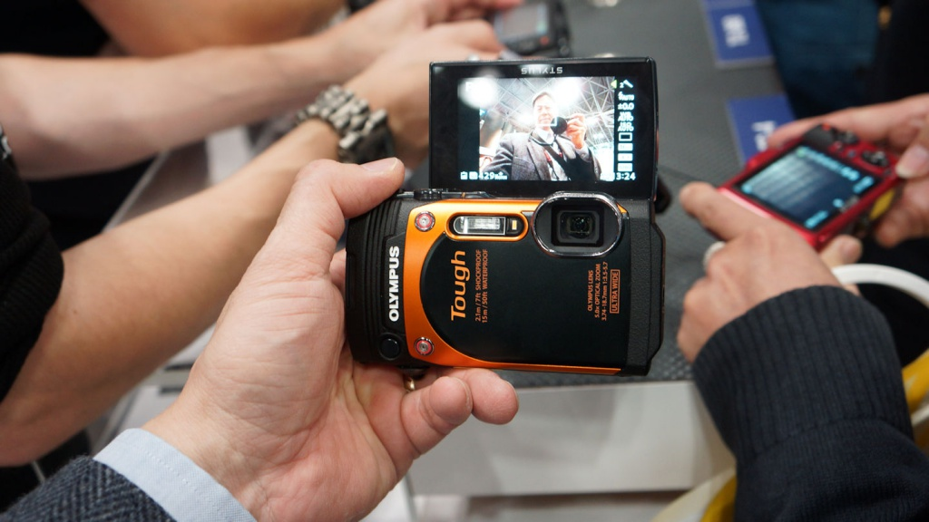The Olympus Tough TG-860 has a flip-up LCD.