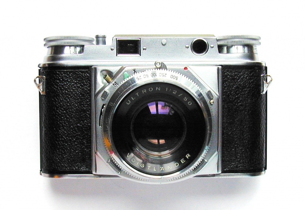 Another controversial choice is the Voigtlander Prominent, which is an attractive camera with excellent lenses and terrible ergonomics. How difficult is it to use? You focus the camera by way of a knob on the top deck (where the rewind knob is usually located). It's tightly sprung, forcing you to firmly grip the camera. That makes it nearly impossible to peer through the viewfinder at the same time, because both of your hands are in the way. However, it sold well enough that Voigtlander made several versions of this camera.