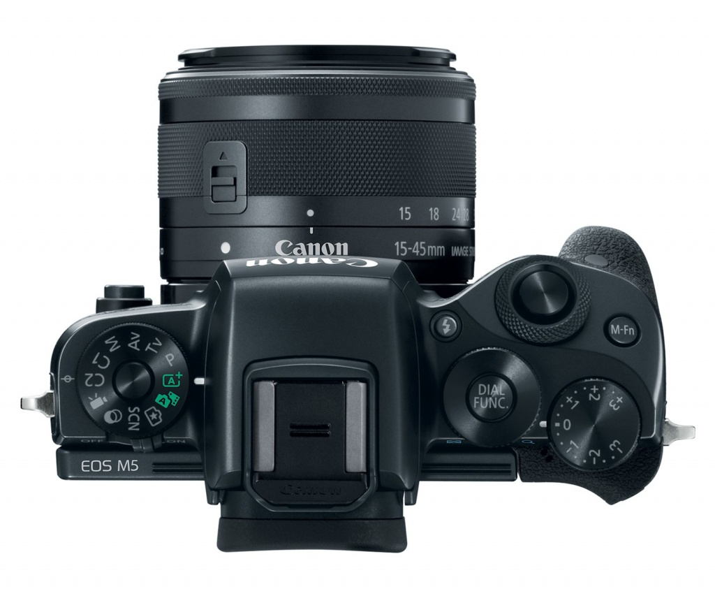 "The top deck and controls of the Canon EOS M5. Note the one dial marked ""Dial func."""
