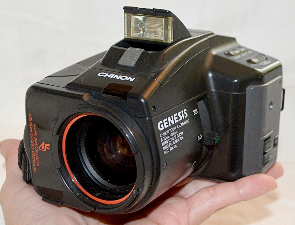 The 1980s were not a nice time for camera design. Check out the zoom lever. Aside from the prolific use of plastic, many cameras had harsh angles and out-of-this world approaches. Check out the zoom lever. The Chinon Genesis sold well enough that there were several generations.