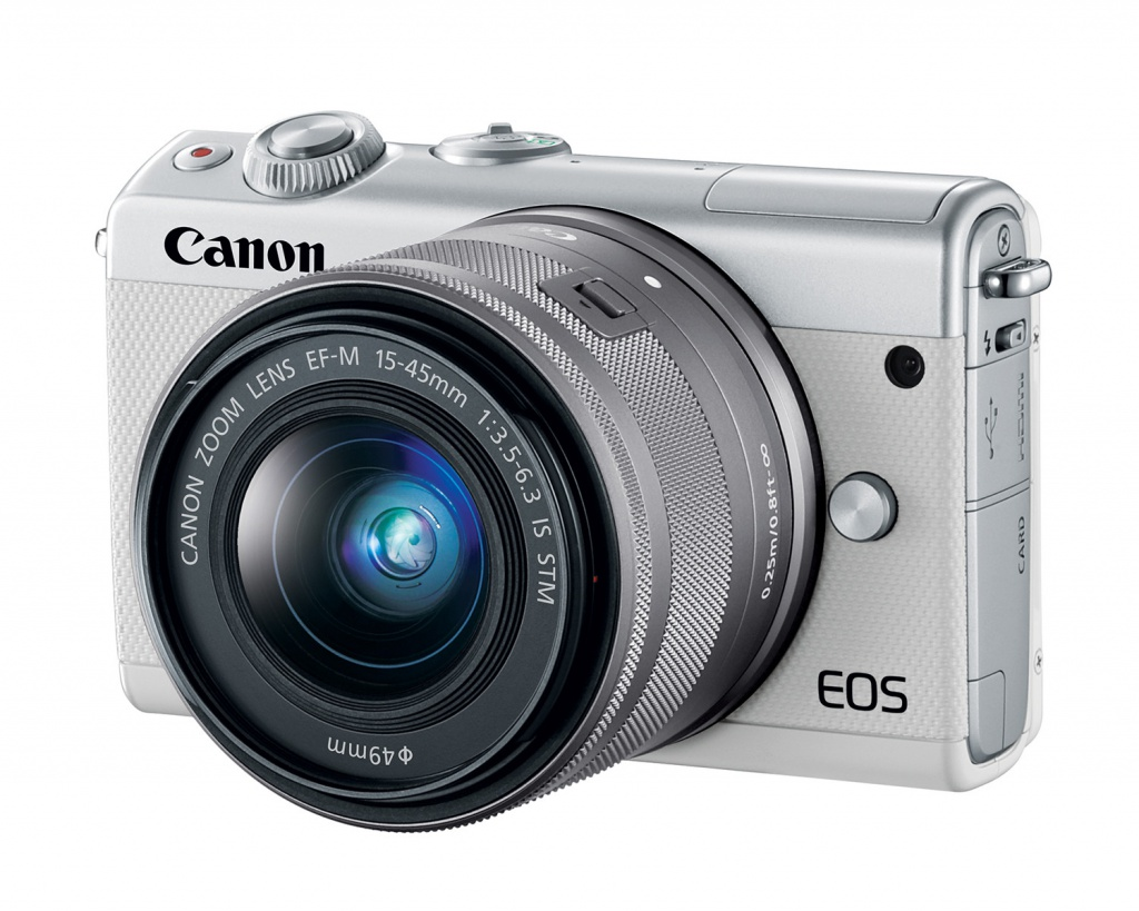 The white Canon EOS M100 and its silver-bodied 15-45mm kit lens.