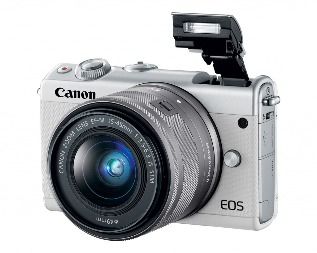 The white Canon EOS M100's pop-up flash.