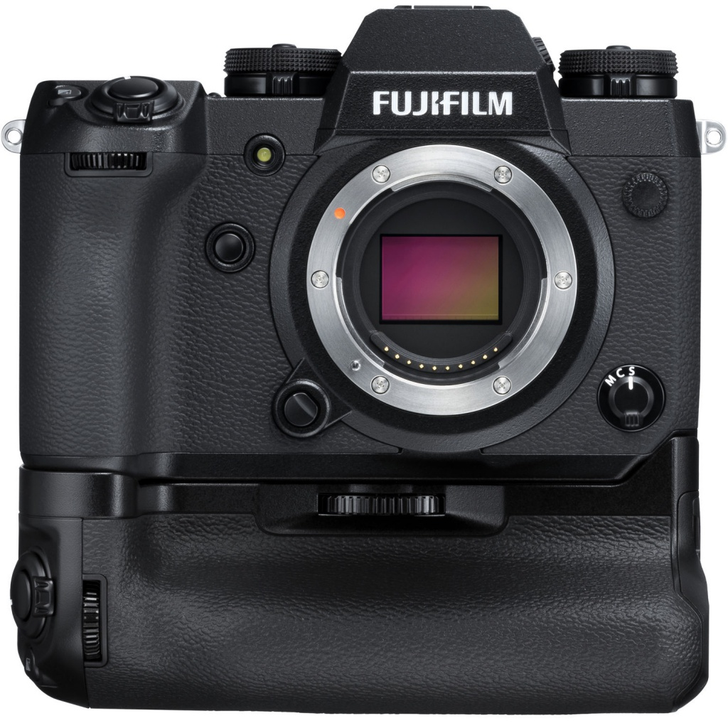 The Fujifilm X-H1 is seen with its accessory battery grip.