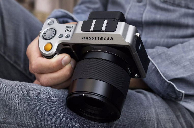 This promotional photo shows the relative size of the Hasselblad X1D.