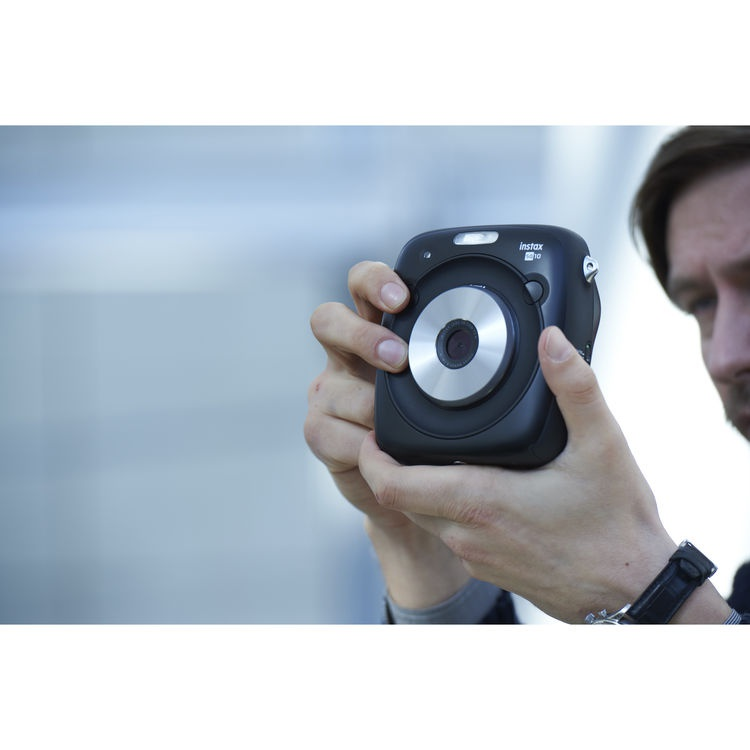This promotional photos shows the size of the Fujifilm Instax Square SQ10.