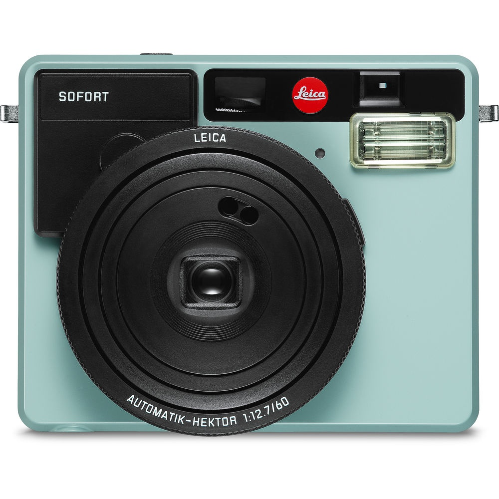 The Leica SOFORT in Mint. The front of the camera shows the lens, flash, viewfinder and a small mirror to aid when taking selfies.