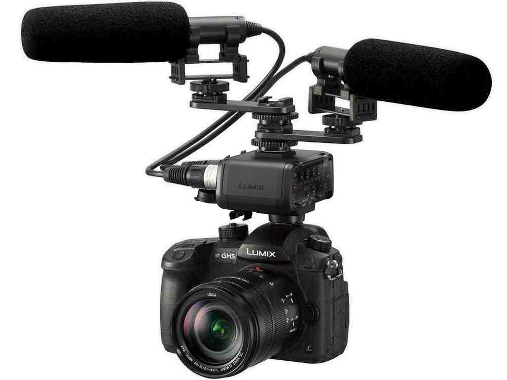 This promotional photo shows two XLR shotgun microphones fed into the Panasonic Lumix GH5's optional microphone adapter.