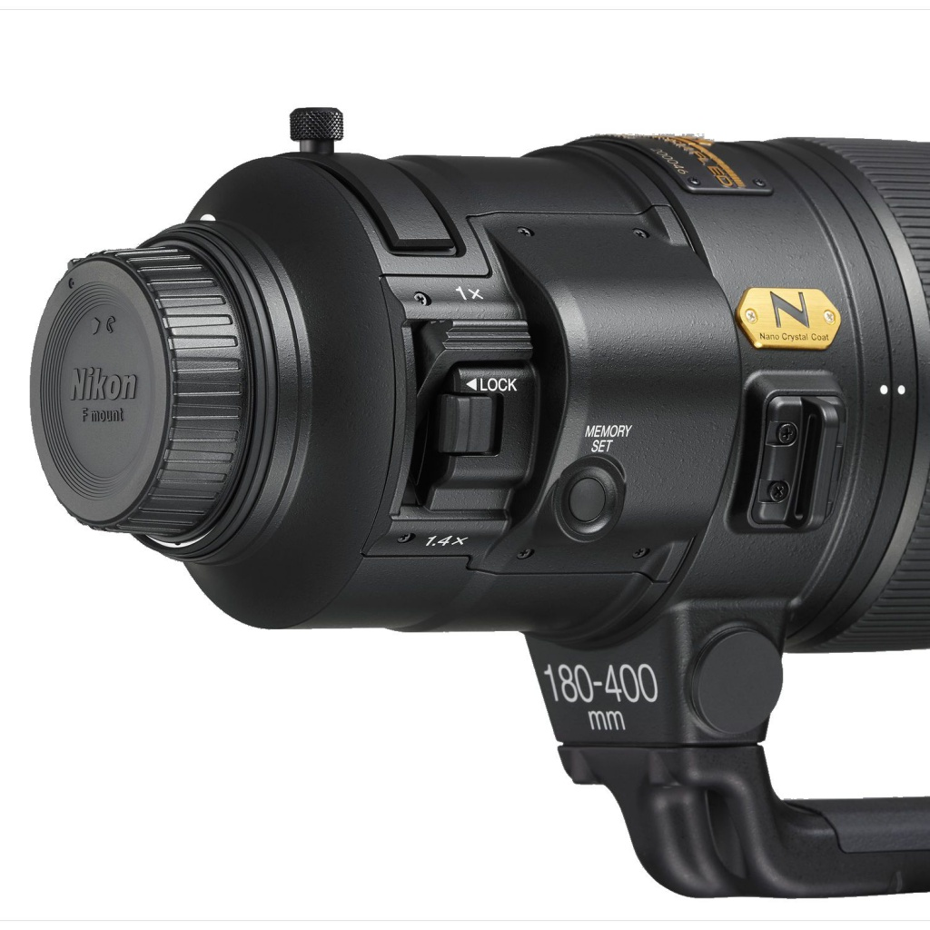 The small knob on top of the AF-S Nikkor 180-400mm f/4 E TC1.4 FL ED VR is to access the slot that accepts 40.5mm drop-in filters.