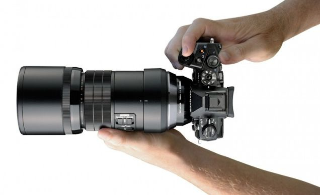 This photo from Olympus shows the size of the M.Zuiko ED 300mm f4.0 IS PRO when mounted to an OM-D series camera.