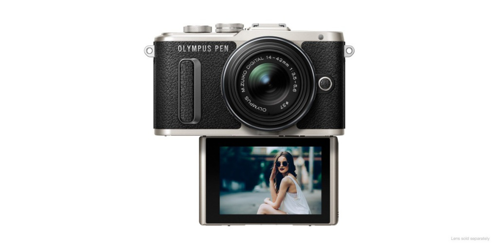 The Olympus Pen E-PL8's LCD screen flips downward and correctly orients the on-screen image.