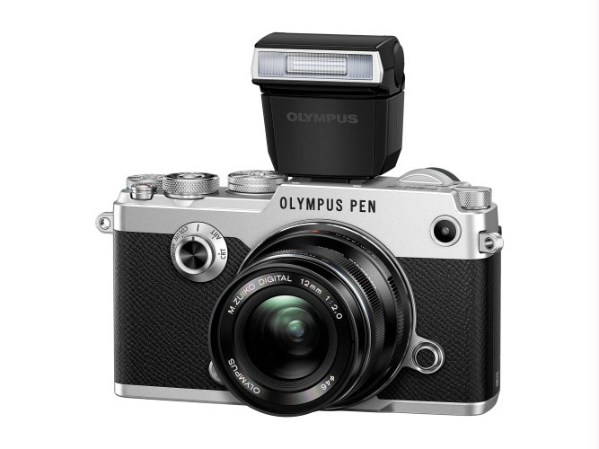 Olympus PEN-F has no built-in flash. One can be slid into the hot shoe.