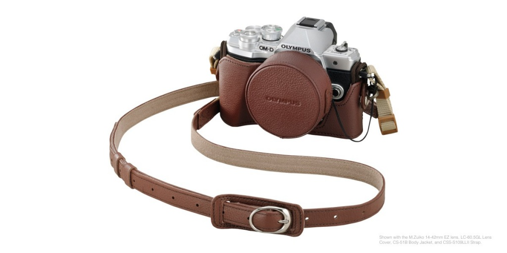 The optional half case for the Olympus OM-D E-M10 Mark III includes a cap for the kit lens.