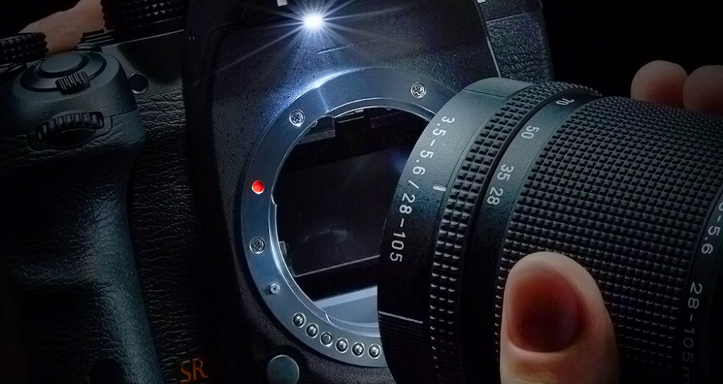 The tiny LED lamp throws some light on the lens mount.