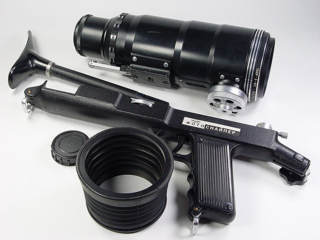 """We'll close with something that isn't even a camera. It's the """"Made in the USSR"""" PhotoSniper, which has """"NO!"""" written all over it. While the idea of attaching a camera to a gunstock wasn't new and can be effective for handling a long lens, using the PhotoSniper today is just asking for trouble. Use at your own peril, particularly in a large city."""