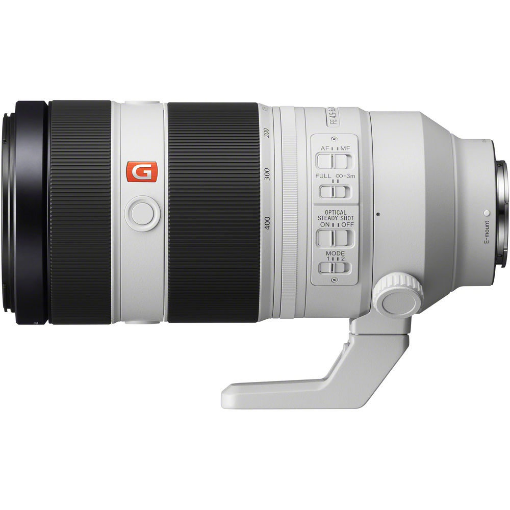 The Sony FE f/4.5-5.6 100-400mm GM OSS lens controls are near the removable tripod collar.